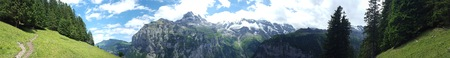 Panoramic of hills and mountains in Swiss alps.