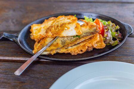 Main dish a fish pan with potatoes