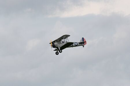 Munderloh, Germany - August 18, 2019: An old American biplane flies over the small airfield