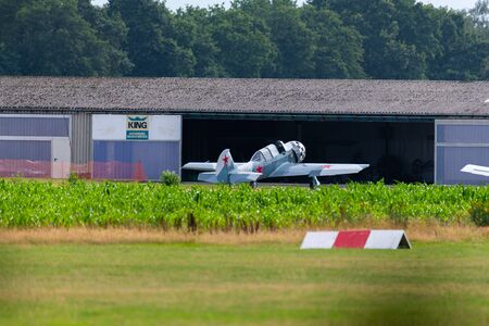 Munderloh, Germany - August 18, 2019: Aircraft are standing on a small airfield where a music event takes place
