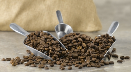 A pile of coffee beans in scoops. Reklamní fotografie