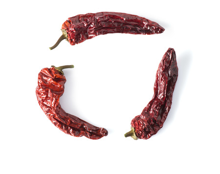 depict: Dried chili peppers arranged in a circle, could also be used to depict the recycling symbol.