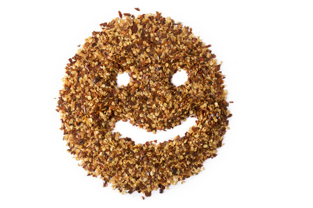 pepper flakes: A pile of crushed red pepper flakes showing a smiley face, depicting love for spicy foods.