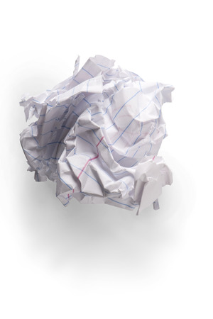 crinkled: A piece of crumpled up notebook paper in a ball, on white with shadow.