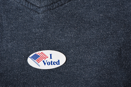 voted: An American I voted sticker placed on a navy shirt.