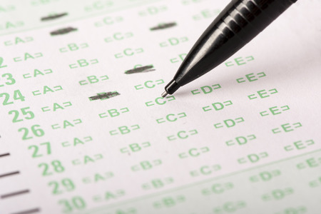answer: An answer sheet or optical mark recognition sheet with a mechanical pencil about to fill in an answer. Stock Photo