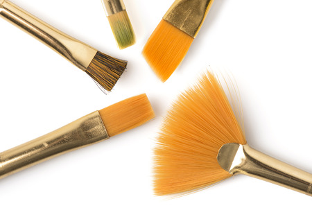 several: Several paintbrushes angled on a white background. Stock Photo