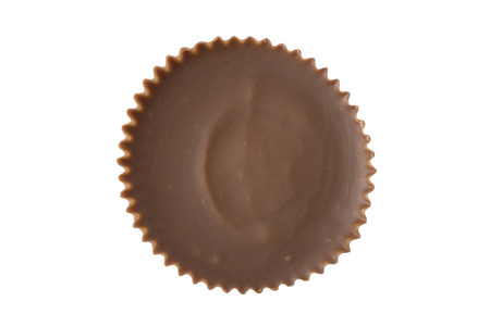 A single peanut butter cup chocolate viewed from straight overhead. Stock Photo