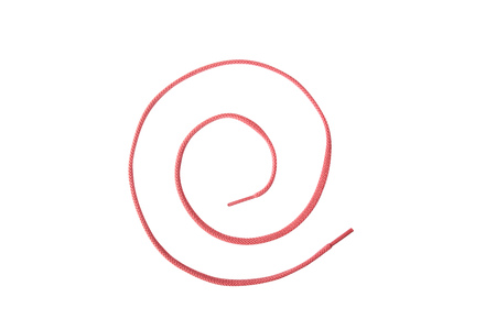 A red colored shoelace shaped into a spiral, isolated on white