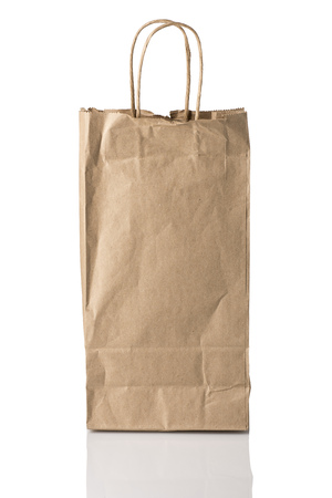 possibly: A brown paper bag, possibly for alcohol, facing forward, isolated on white with reflection.