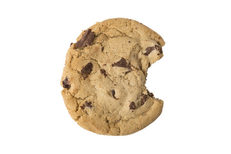 A chocolate chip cookie with a bite taken isolated on white.