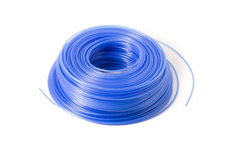A spool of blue trimmer line for a weed eater.