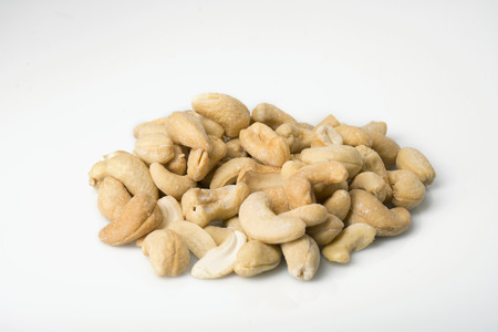 angled: a pile of salted cashews angled on white. Stock Photo