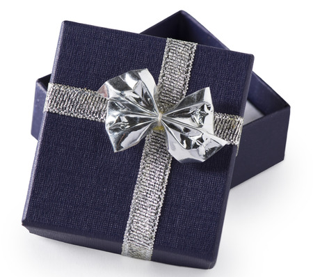 possibly: A tiny navy blue gift box with silver bow, possibly for jewelry, opened, isolated on white.