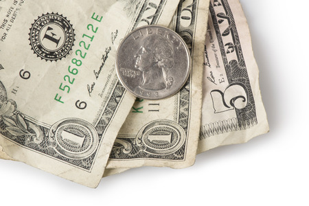 salarios: Wrinkled dollar bills and a quarter adding up to $7.25, the current (as of 2016) U.S. Federal Minimum wage.