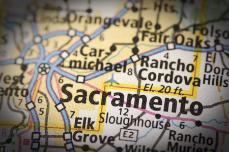 Closeup of Sacramento, California on a road map of the United States. Imagens