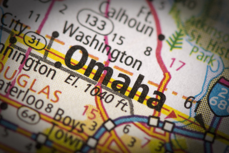 Closeup of Omaha, Nebraska on a road map of the United States.