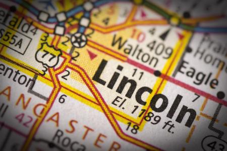 nebraska: Closeup of Lincoln, Nebraska on a road map of the United States. Stock Photo