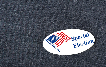 Closeup of a sticker with an American flag and the words