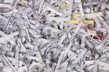 Closeup of Shredded Paper from a paper shredder with a few colored pieces
