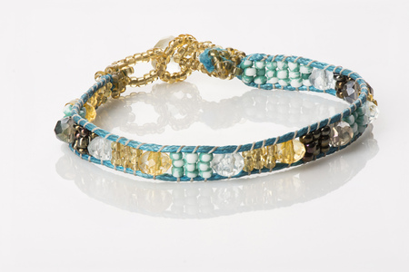 Womens Beaded Bracelet - Turquoise & Gold, on white with reflection