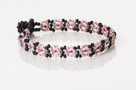 Womens Beaded Bracelet - Pink and Black, on white with reflection