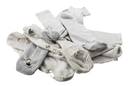 Pile of old white socks with holes, isolated on white. Stock fotó