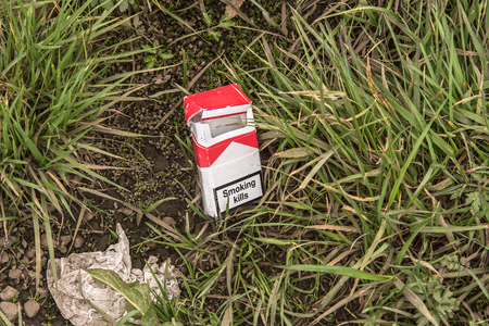 An empty pack of cigarettes with the text,