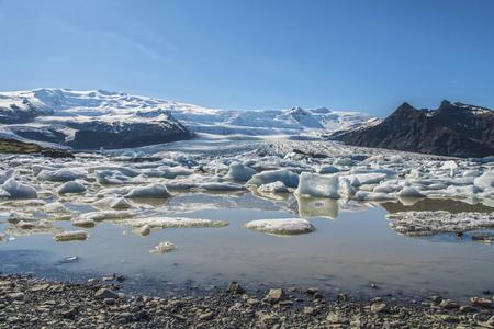 Fjallsárlón Glacier Lagoon in Southeast Iceland showing floating icebergs.