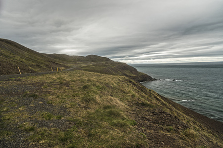 Coastline of the northern tip of Trollaskagi Peninsula, Iceland with the road winding through