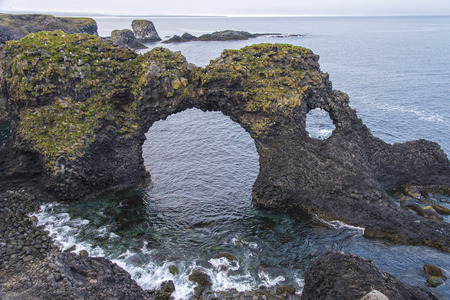 View of Gatklettur natural arch, Arnarstapi, Iceland Фото со стока