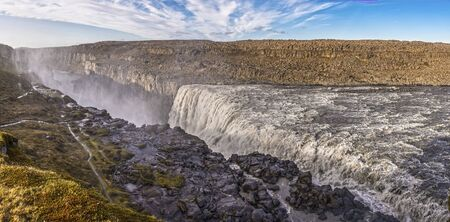 View of Dettifoss Waterfall, Iceland and the surrounding landscape.