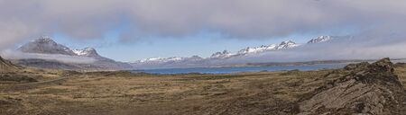 Panoramic view of Mountains and Ocean near Teigarhorn Natural Monument, Iceland Фото со стока