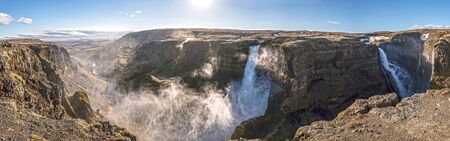 Panoramic view of Haifoss Waterfall in Iceland and the surrounding valley.