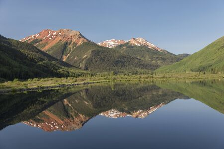 Mountains along Million Dollar Highway in Western Colorado, reflecting on Crystal Lake Banco de Imagens