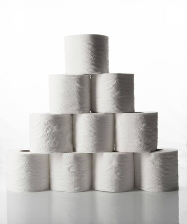 A pyramid of toilet paper rolls with the rolls upright. Banco de Imagens