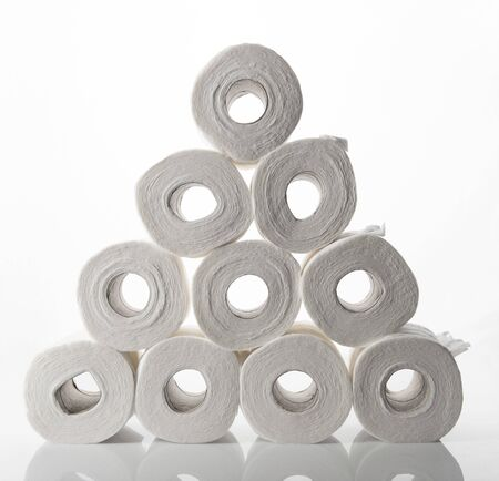 A pyramid of toilet paper rolls with the rolls facing forward.
