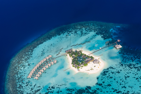 Maldives beach from birds eye view. Aerial view on Maldives island, Ari atoll. Tropical islands and atolls in Maldives from aerial view. Summer holiday beach landscape background in Maldives. Zdjęcie Seryjne