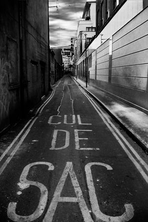 Long street with the inscription CUL DE SAC on it. Black and white image. Stock Photo