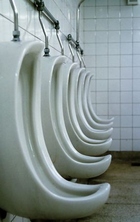 hygienics: Profile detail of mens toilet - bathroom - urinals - (in a row).