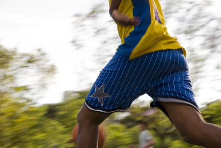 unrecognisable: Detail of unrecognisable basketball players with park-like background. Stock Photo