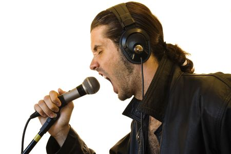 Profile of a young man in a leather jacket shouting in a microphone. Stock Photo