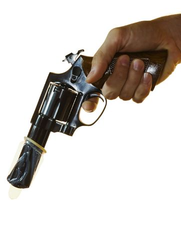 calibre: Cropped shot of a male hand holding a .38 calibre with a condom on it.