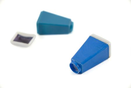 tiny lenses: Two small photograph viewers over white background.