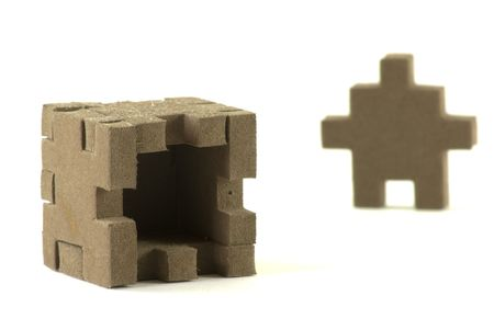 Foam material box with puzzle shaped sides.