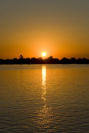 deep orange: Sunset over a calm lake with deep orange hue. Lots of copy space.