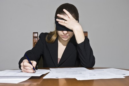 careless: Blindfolded businesswoman signing papers