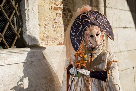Traditionally dressed Venice carnival  female performer in Piazza San Marco, Italy Stock Photo