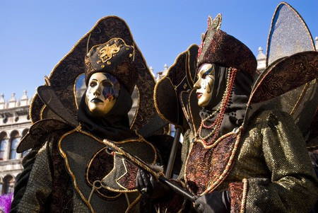 Traditionally dressed Venice carnival couples in Piazza San Marco, Italy Stock Photo
