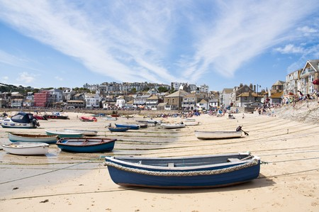 SAINT IVES, CORNWALL - AUGUST 8: Tourists and locals enjoy the beach during a low tide in St. Ives, in Cornwall, Southern UK August 8, 2010 in Saint Ives, Cornwall, UK.